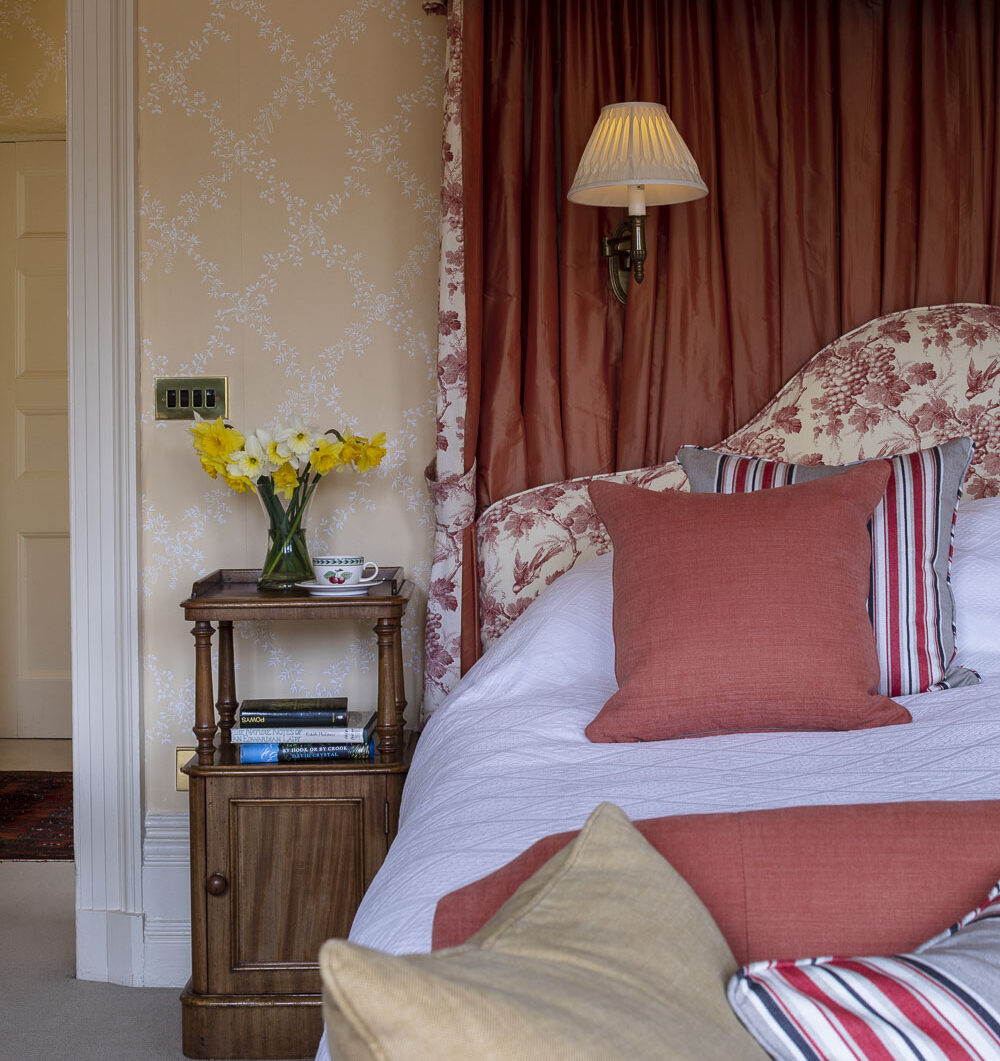 showing detail of bedroom of luxury country house hotel